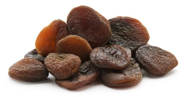 Group of dried natural Apricots isolated on white